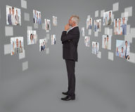 Mature businessman looking at digital interface Royalty Free Stock Photography