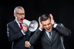 Mature businessman with loudspeaker Stock Photo