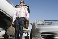 Mature Businessman With Luggage At Airfield Stock Image
