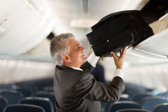Mature businessman luggage Royalty Free Stock Photos