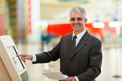 Mature businessman machine Royalty Free Stock Image