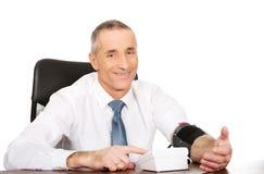 Mature businessman measuring blood pressure Royalty Free Stock Photo