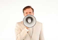 Mature businessman with megaphone. Mature businessman making a announcement with megaphone and looking at the camera Stock Image