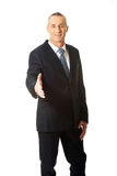Mature businessman offering handshake Royalty Free Stock Images