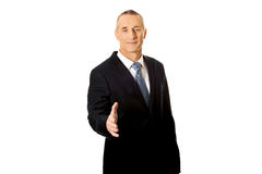 Mature businessman offering handshake Royalty Free Stock Photography