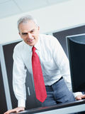 Mature businessman in office Royalty Free Stock Image