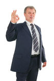Mature businessman with ok sign Stock Photos
