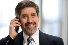 Mature businessman onthe cell phone Royalty Free Stock Photo