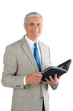 Mature Businessman with Open Binder Royalty Free Stock Photo