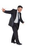 Mature businessman performing a balancing act Stock Photography
