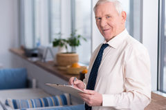 Mature businessman perusing a document Royalty Free Stock Photos