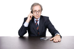 Mature businessman with phone Royalty Free Stock Image