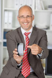 Mature Businessman Pointing At Cell Phone Stock Photos