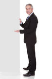 Mature Businessman Pointing At Placard stock photography