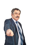 Mature businessman pointing to you Royalty Free Stock Photos