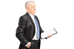 Mature businessman posing with clipboard Royalty Free Stock Images