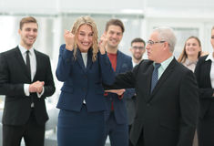 Mature businessman praising coworker during a meeting Royalty Free Stock Photos