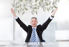Mature Businessman Raising Arms Royalty Free Stock Image