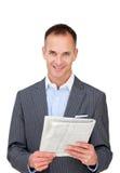 Mature businessman reading a newspaper Stock Photography