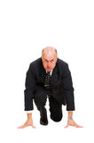 Mature businessman ready for race Royalty Free Stock Photo