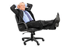 Mature businessman resting in armchair Royalty Free Stock Image