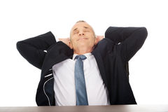 Mature businessman resting in armchair Royalty Free Stock Photo