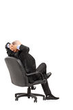 Mature businessman resting in armchair Royalty Free Stock Photography