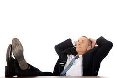 Mature businessman resting in armchair Stock Photos