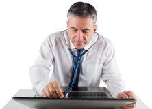 Mature businessman running diagnostics on laptop Stock Image