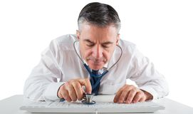 Mature businessman running diagnostics with stethoscope Royalty Free Stock Photography