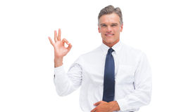 Mature businessman saying ok with hand Royalty Free Stock Photography