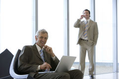 Mature businessman seated Stock Photos