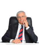 Mature Businessman Seated at Desk Royalty Free Stock Photography