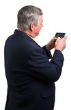 Mature businessman sending text message Stock Photos