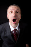 Mature businessman shouting at camera Stock Images