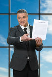 Mature businessman showing contract. Stock Photo