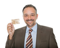 Mature businessman showing a credit card Stock Photo