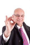 Mature Businessman signaling ok Stock Photo