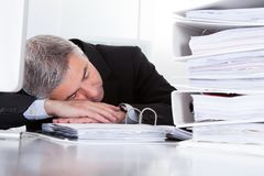 Mature businessman sleeping at desk Royalty Free Stock Photo