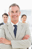 Mature businessman smiling at camera Royalty Free Stock Photo