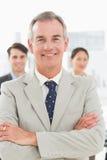 Mature businessman smiling at camera Royalty Free Stock Photo