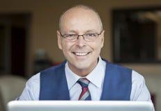 Mature Businessman Smiling At The Camera. Stock Photo