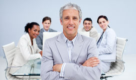 Mature businessman smiling in a meeting Royalty Free Stock Photo