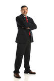 Mature Businessman standing with crossed arms Stock Photos