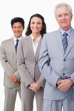 Mature businessman standing with employees Stock Image