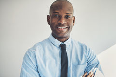 Mature businessman standing with his arms crossed in an office Royalty Free Stock Image