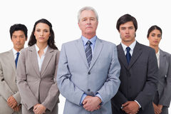 Mature businessman standing with his colleagues Stock Photo