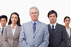 Mature businessman standing with his team Royalty Free Stock Photos