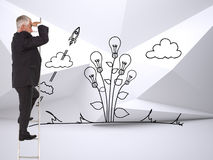Mature businessman standing on ladder. Composite image of mature businessman standing on ladder watching royalty free stock photo