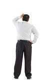 Mature businessman standing scratching head Stock Photos